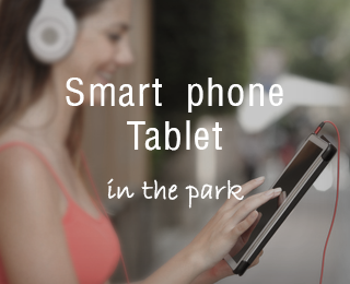 Smart phone Tablet in the park